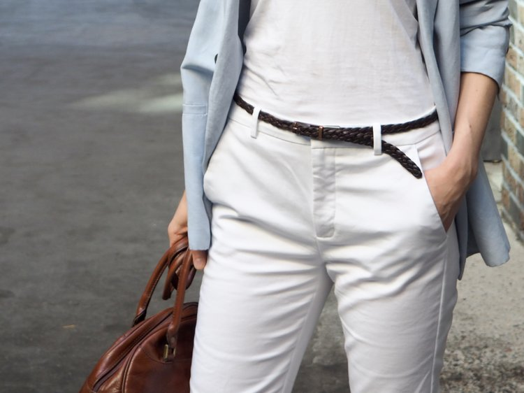 8f759d64d857 Braided brown leather belt worn with white trousers, white T-shirt, blue  blazer