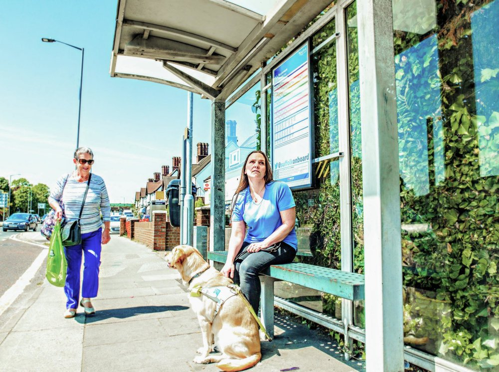 Emma Free and her Guide Dog Lucy waiting for a bus, one of her most dreaded tasks.