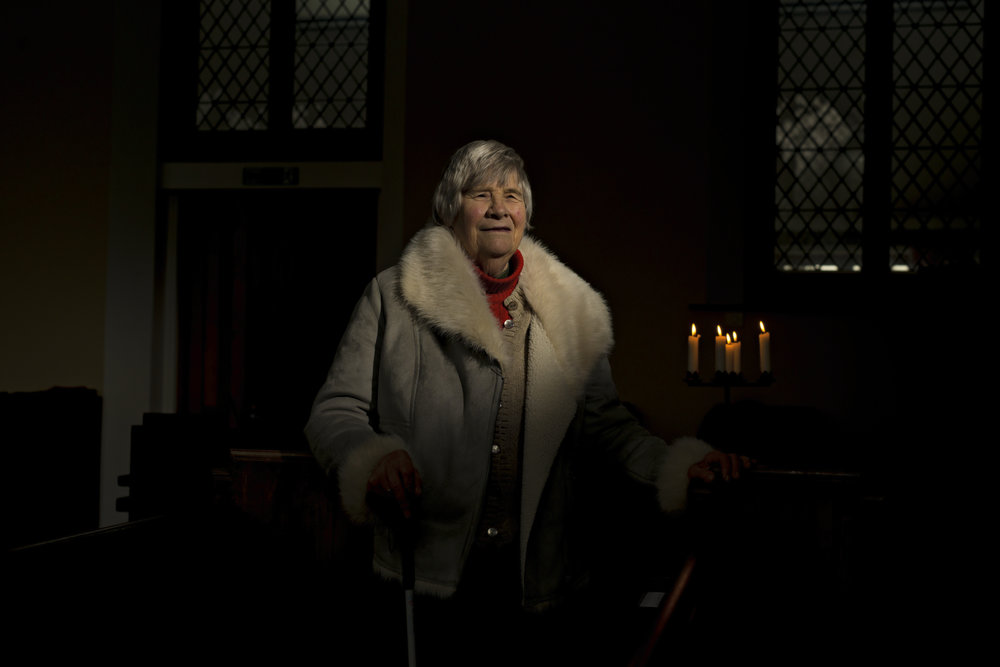 77 year old Denise Tiller photographed inside her local Church. Denise's deep religious devotion and convictions to her faith is a source of great joy for her.