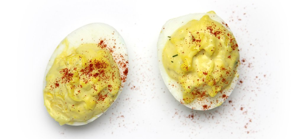Deviled Eggs - Deviled eggs are absolutely a hit basically anytime, anywhere. We just had some for brunch just because. They're a great finger food and they're easy to make ahead, store in the fridge and then serve when the family arrives. Turn on some football or college basketball and most everyone will be more than happy to hang out until it's time to carve the turkey.Looking to jazz up the regular deviled eggs recipe and get a lil fancy? Read this.