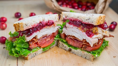 Turkey & Cranberry Club Sandwich - We always have leftover cranberry sauce. It seems like maybe it's not everyone's favorite when lumped onto the plate. But tucked into a delicious club? Yessssss! It works. Add some turkey, LTO and bacon, of course, and you've got a killer meal. You can always build it up like a proper club sandwich, with an additional slice of bread and doubled up fillins'. Up to you. We like ours on rye. You do you. Just know you're getting a delicious lunch in the days following Thanksigiving.