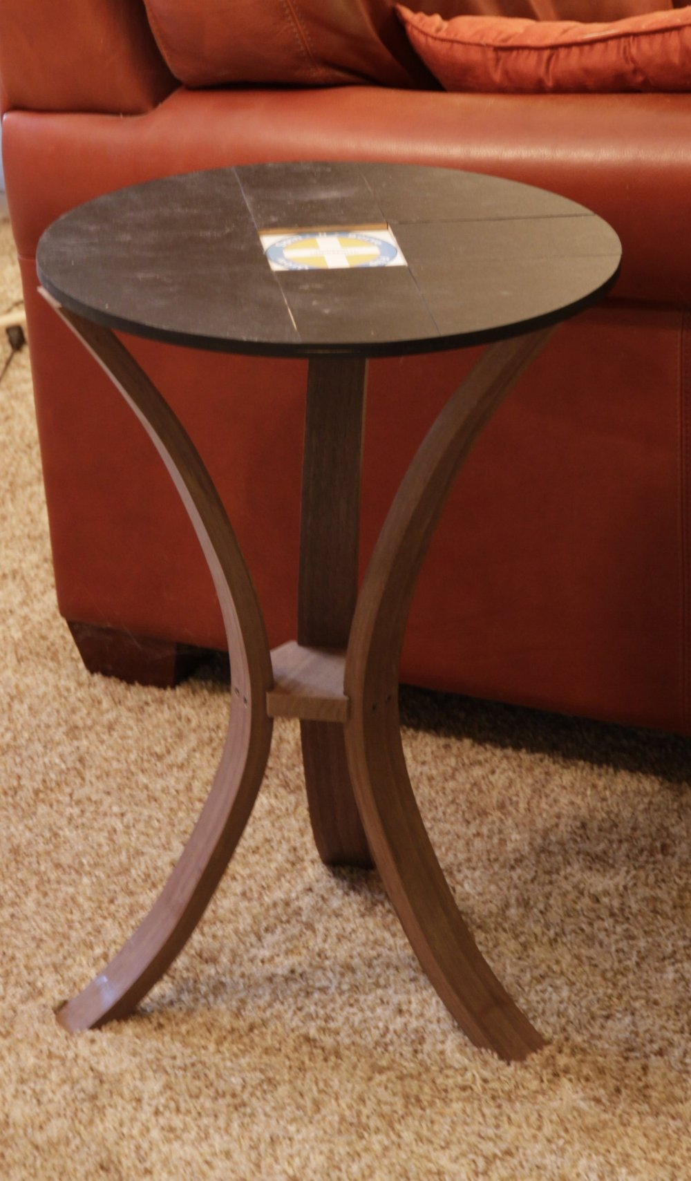 Start by placing the base on the table legs. - (Works with both the 18 and 24