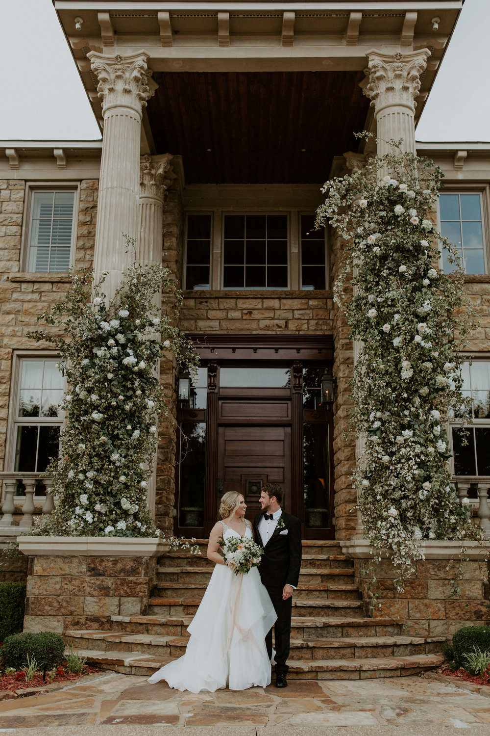 We got married at Daniel's house. His house has these beautiful columns at the steps we were going to get married on. Jessica and I talked about making a big impact with the columns. These columns are TALL, you guys. I don't even know how TLF pulled this one off.