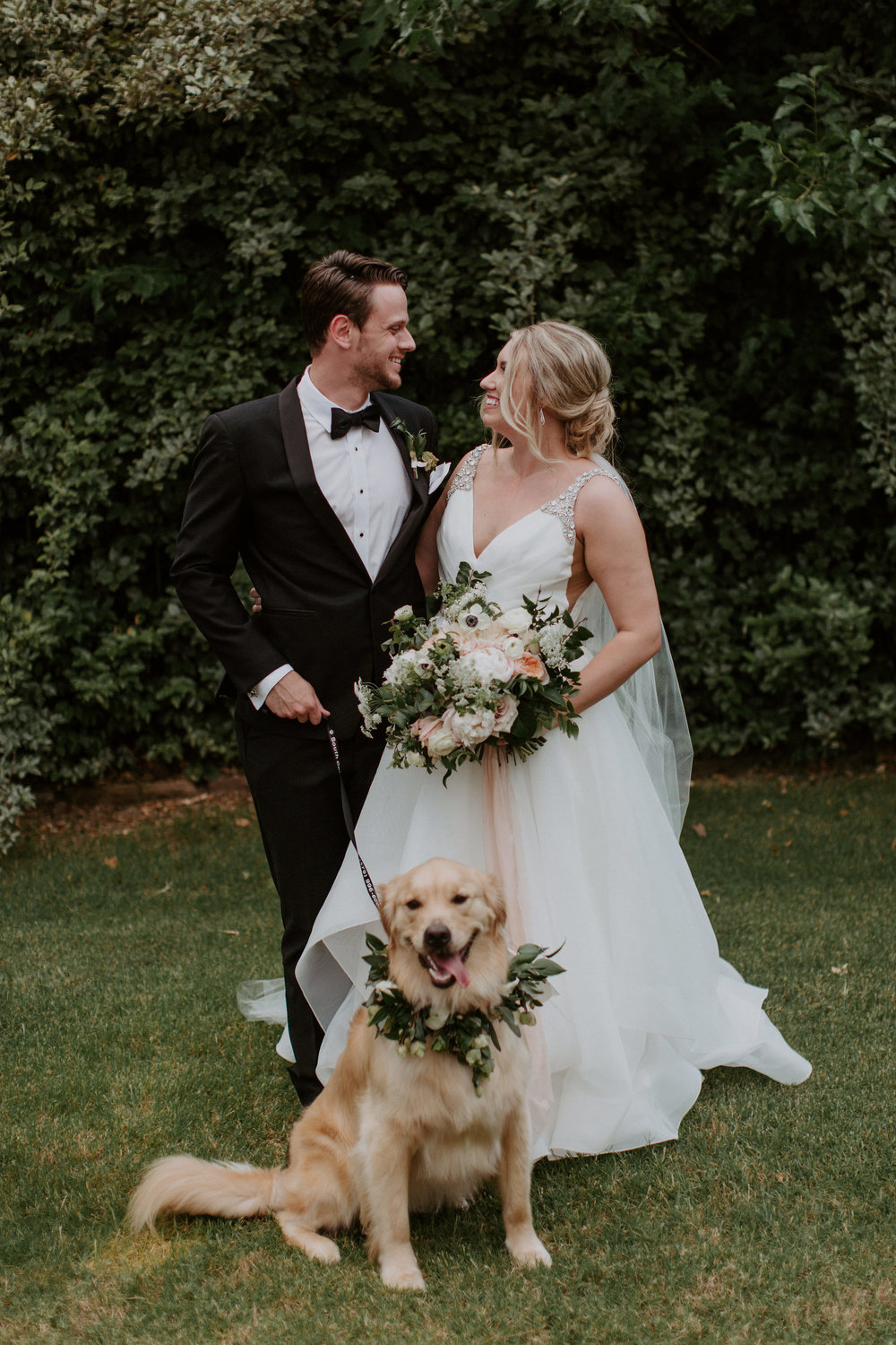 Daniel and I wanted our pup, Nelson, to be a part of the wedding day. He walked out into the ceremony with the groomsmen, so of course he needed to have a floral collar. He was the real star of the show, if you ask me.
