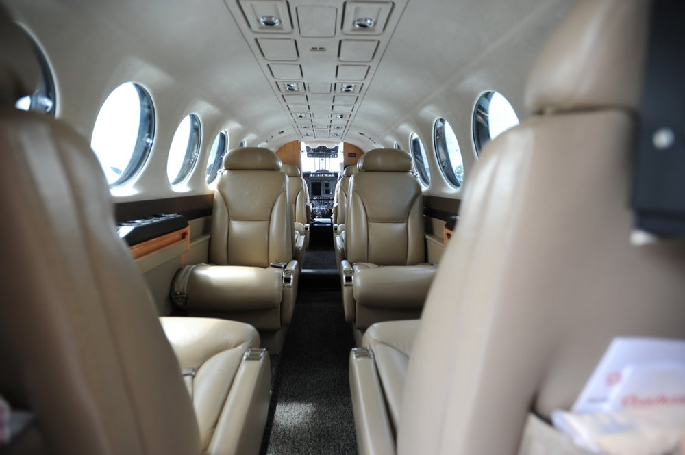 Interior of a Beechcraft King Air 300 series. The -200 series has an identical cabin width. Above banner: Beechcraft King Air.