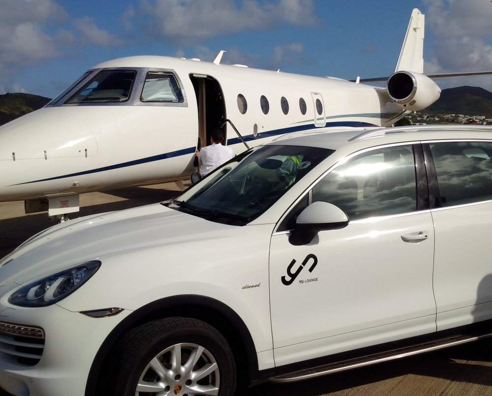 FBOs provide a top-notch welcome experience for private fliers, such as this chauffeured Porsche Cayenne at the Yu Lounge, St. Kitts/ St. Kitts and Nevis.