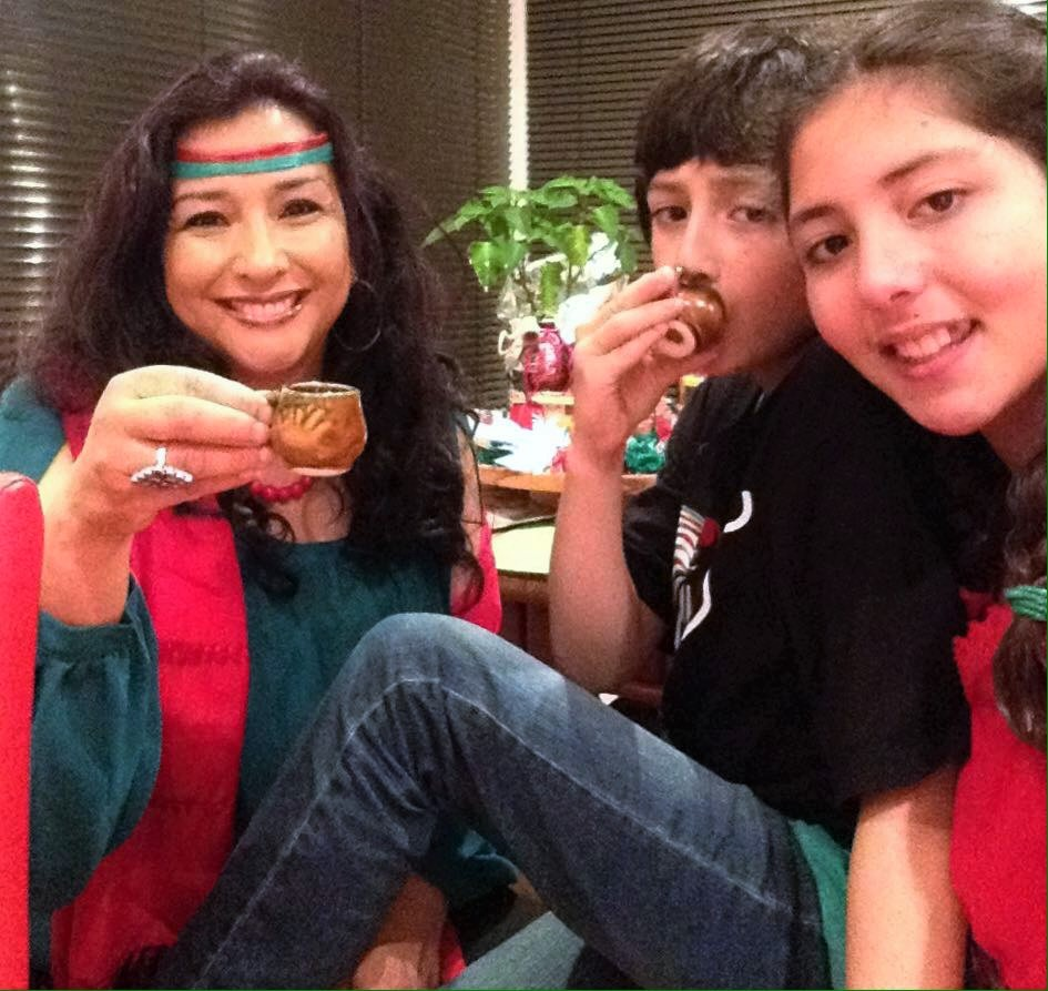 Maria Elena, Andre and Aneliza celebrating the Mexican Independence Day (toasting with apple juice).