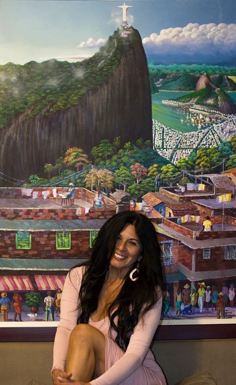 Elizabeth next to a painting showcasing Brazil.