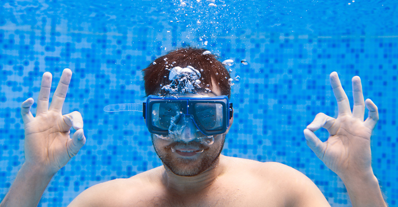 bigstock-Young-Man-In-Diving-Mask-Swimm-197598550 copy.jpg