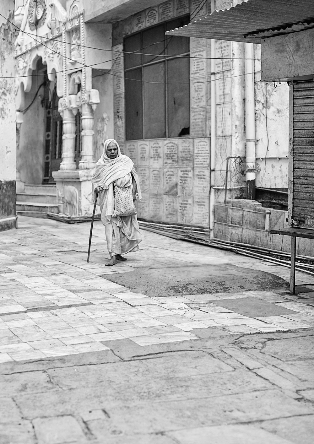 widows of vrindavan :: walking to the temple.jpg