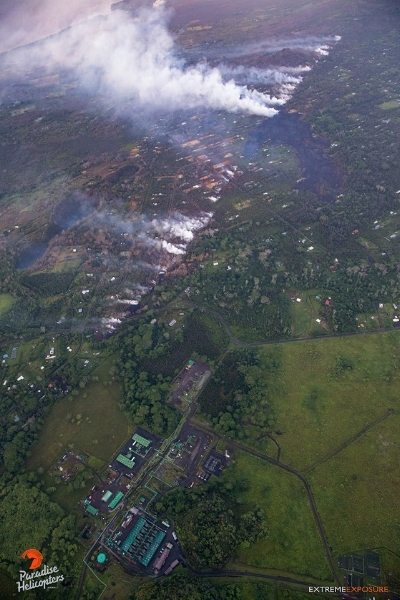 "May 10, 2018 From  Bruce Omori  "" Aloha awakea... Here's pic from this morning's overflight, showing the fissure that erupted on Wednesday, crossing Pohoiki Road, inching closer to the Puna Geothermal Venture facility. Please keep the residents of Leilani Estates and surrounding communities in your prayers! Mahalo!! And, mahalo nui  Paradise Helicopters  for the STELLAR charter service!!!  Extreme Exposure Fine Art Gallery   Hot Seat Hawaii  — with  Puna Geothermal Venture ."""