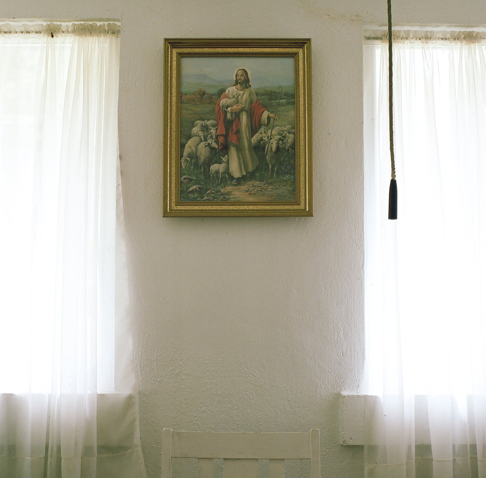 Alan Pittman. March 22, 2014. A portrait of Jesus hangs near the bell-tower rope in one of the classrooms at Valley Grove Methodist Church, Charleston, Kanawha County, West Virginia.