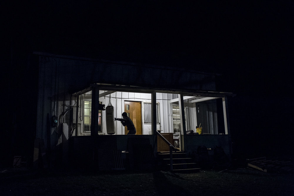 Sam Owens . January 3, 2016. Dakota Flowers spends an hour boxing on the front porch, eventually busting his hand open, at his house. Flowers, who works out nearly every day in-between his busy schedule of working for Coalfield Development Corporation and going to community college. Lincoln County, West Virginia.