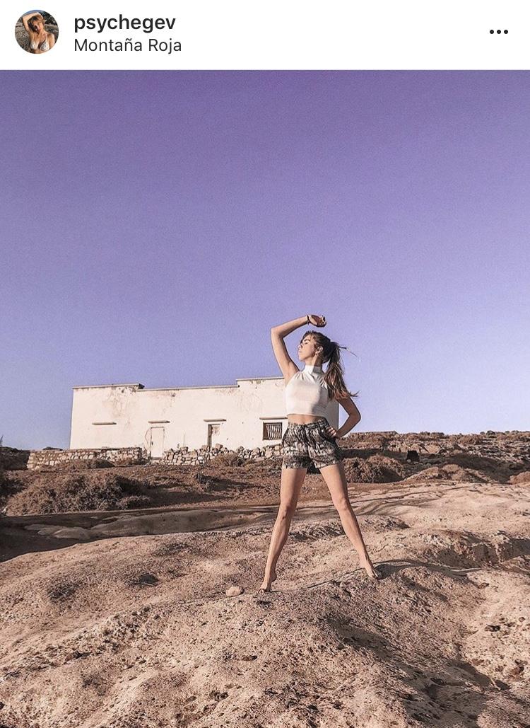 girl power posing in desert strong