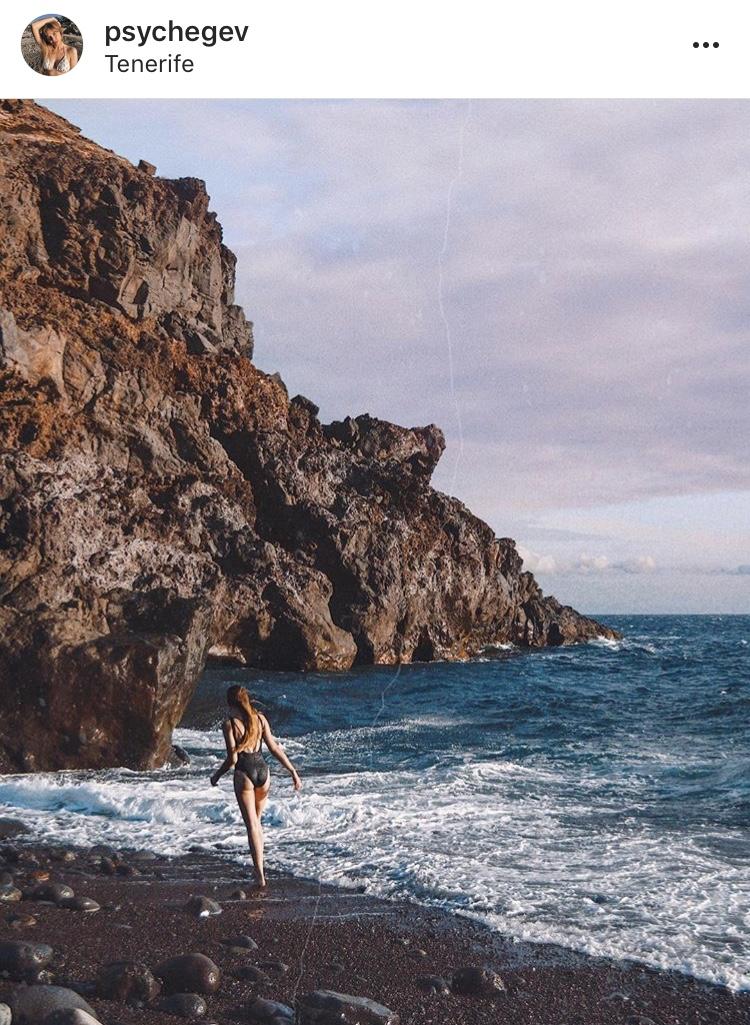 blonde girl walking at beach in tenerife