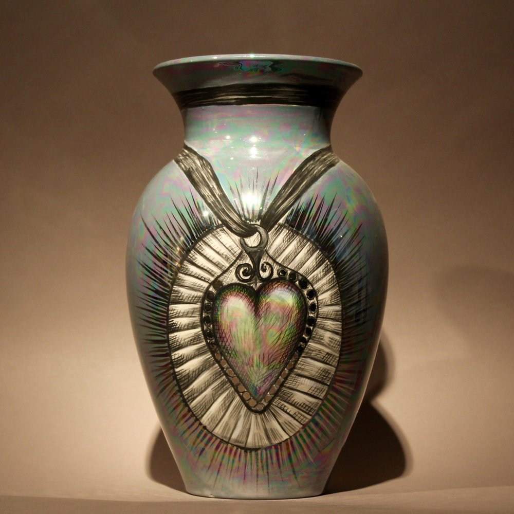 """Dimensions: 12"""" H  Year: 2013  Medium: Luster and Silver overglaze on low fire ceramic vase  Cost: $2500"""