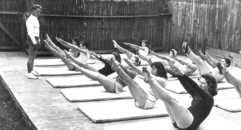 "What is Pilates? - ""CHANGE HAPPENS THROUGH MOVEMENT AND MOVEMENT HEALS."" - Joseph PilatesOver a 60 year period of time, Joesph Pilates created what is know as Pilates today. He saw proper movement, awareness of breath, and physical fitness as gateways to happiness. Pilates is rooted in body awareness. By understanding how the body aligns and moves individuals can heal from injuries, recover from childbirth, improve their athletic endeavors, or just find joy in movement.If you want to find out more about Joe, check out the video below!"
