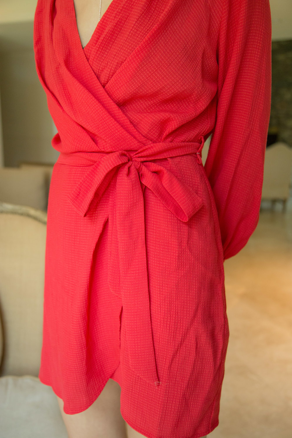 """You don't have to be selfconsious when wearing this wrap dress because it is very secure. There are button closures on both sides of the waist on the inside of the dress as well as the tie detail so you never have to worry about it """"opening"""" up on you."""