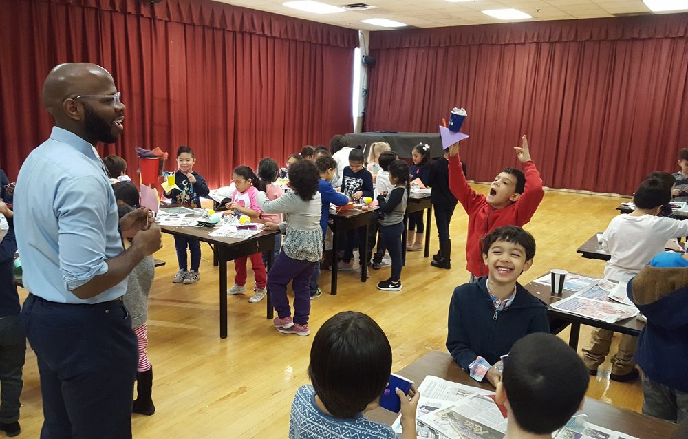 Puppeteer Emmanuel Elpenord visits a Jackson Heights school to teach a puppet-making workshop. November 2017.