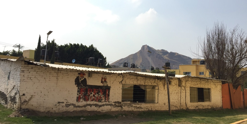 The Panchos' head office stands in humble contrast to the houses around it. Photo by Rachel Rowe