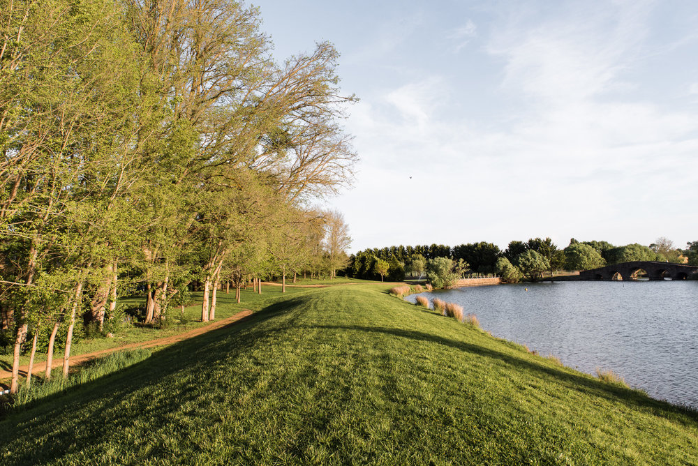 Lake and rolling lawns and country space