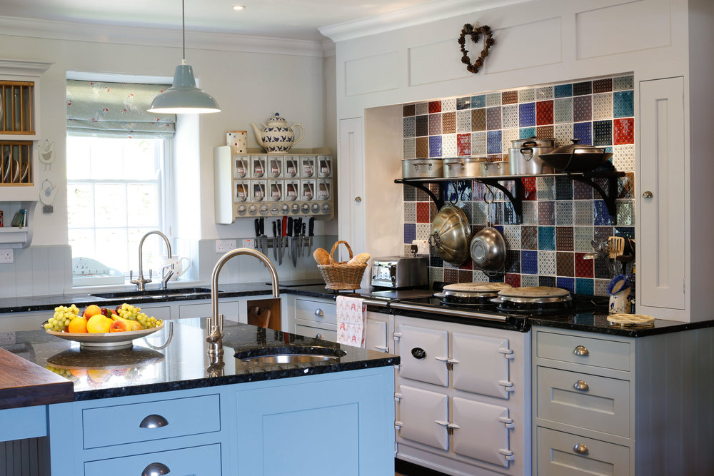 """""""The flow of the kitchen is so much better now… it's a very sociable place."""" - We designed this bespoke kitchen always focussing on the clients want to open up the space. We completely reversed the kitchen to give access through French doors onto the garden and patio, with the main sink now also facing the lovely garden view."""