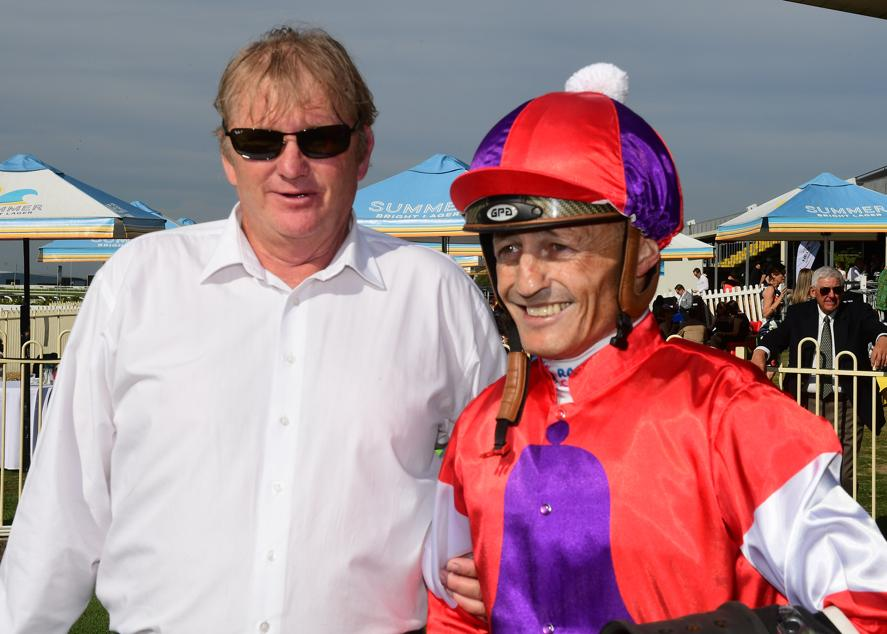 Trainer Kelly Schweida and jockey Damien Browne after Oink's win at Doomben. Image provided by News Limited.