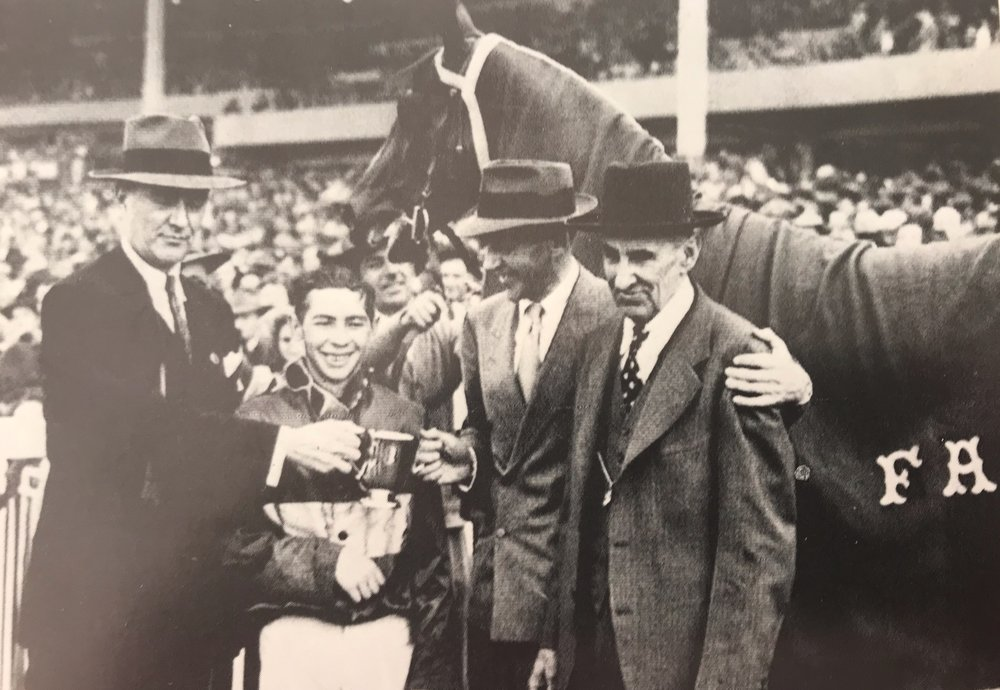 Fred Astaire with an arm around trainer Clyde Phillips after San Juan Capistrano Handicap at Santa Anita 1946.