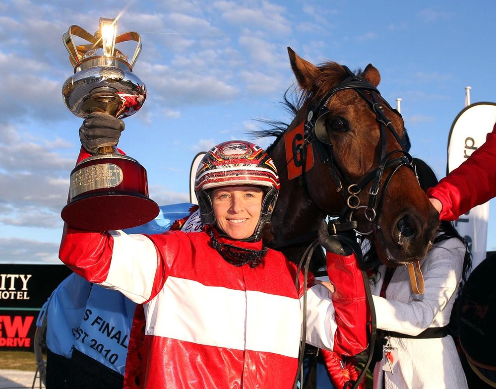 Image courtesy National Trotguide - Lisa with trophy after Breeders Crown 4YO Final.