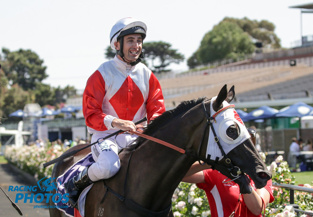 Image courtesy Racing Photos - Anthony returns to scale after his first Group 1 win.