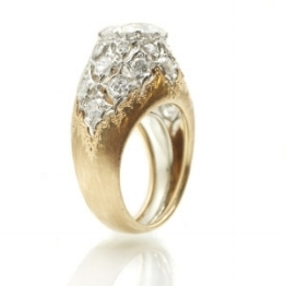 An 18kt. Rose and White Gold Diamond Ring by Mario Buccellati, sold for $21,600
