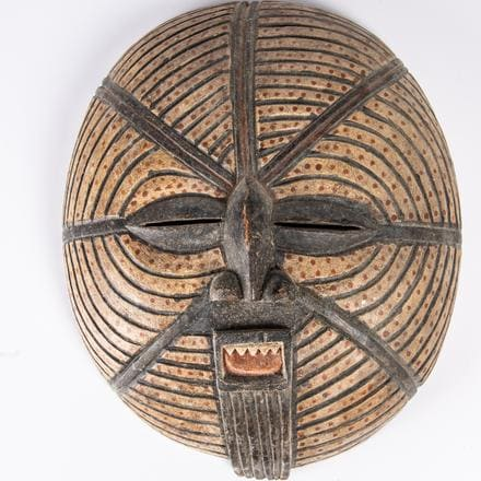 LUBA TRIBE PAINTED WOOD MOON MASK   A Luba Tribe Carved and Painted Wood Moon Mask, Democratic Republic of Congo, 20th Century, Having almond shaped eyes, a small nose and prominent mouth.   Est. $80 - $120