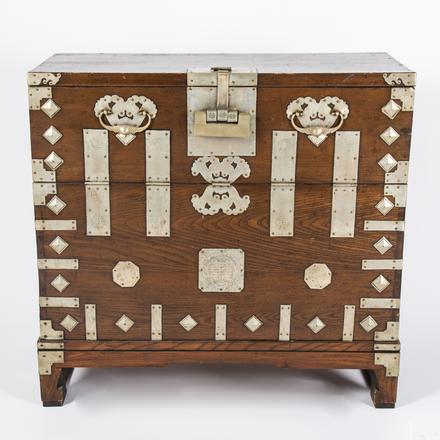 KOREAN STAINED HARDWOOD CHEST   A Korean Stained Hardwood Chest with White Metal Mounts and Pulls, 20th Century.   Estimate: $200 - $400