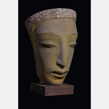 EDRIS ECKHARDT, (1905-1998) - HEAD   The sculpture is mounted to a base with three brass screws and plaster, possibly by the artist.   Estimate: $3,000 - $5,000