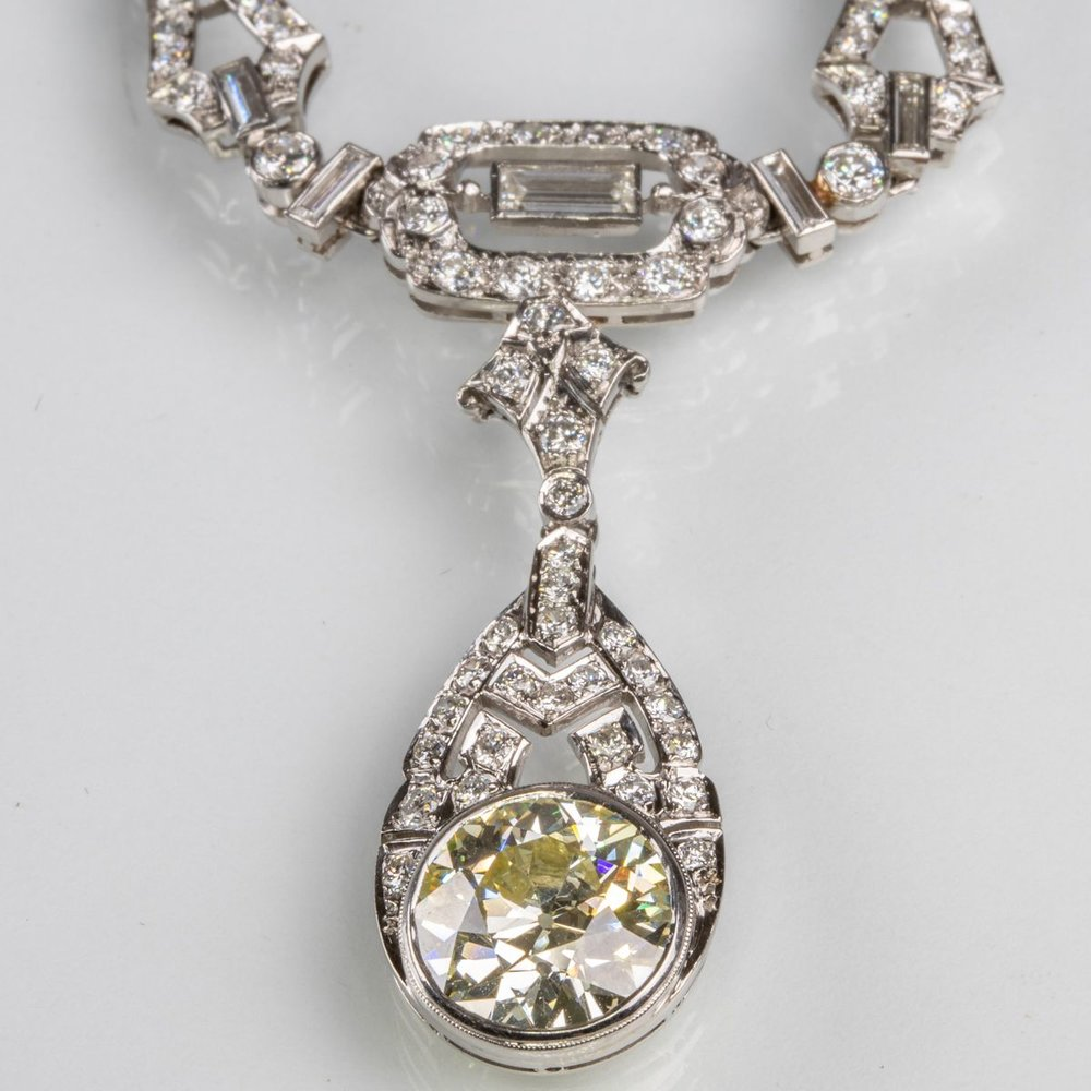 A 14kt. White Gold and Diamond Drop Pendant Necklace, sold $9,000