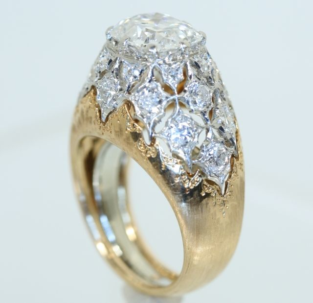 An 18kt. Rose and White Gold Diamond Ring by Mario Buccellati, sold $18,000