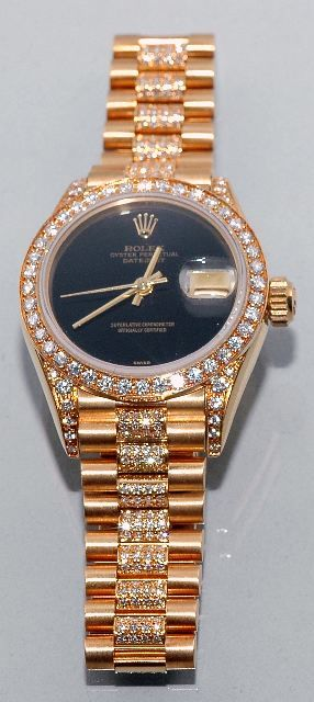 A Ladies 18kt Yellow Gold and Diamond Rolex sold $7,500