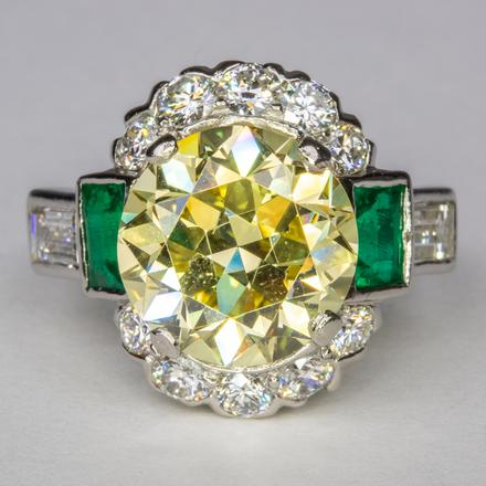 Fancy Yellow Diamond & Emerald ring. Estimated at $35K - $45K, sold for $55K
