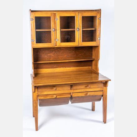 AMERICAN WALNUT HOOSIER CABINET   An American Walnut and Glass Hoosier Cabinet, 19th/20th Century   Estimate: $200 - $400