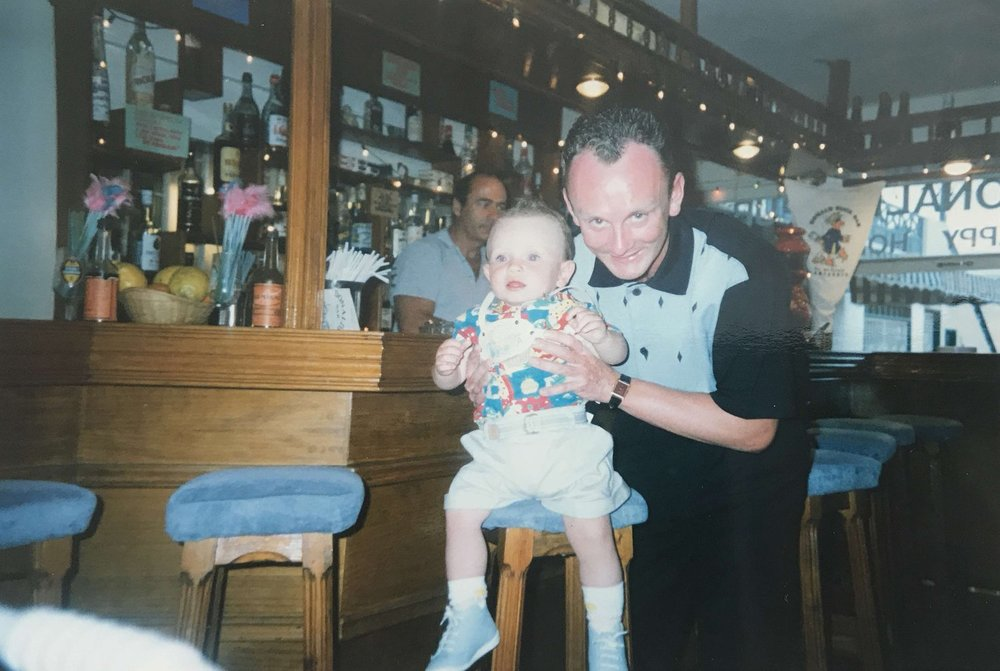 My father, Mark Archibald Reid, holding me (the toddler) a few years after the Piper Alpha Disaster.
