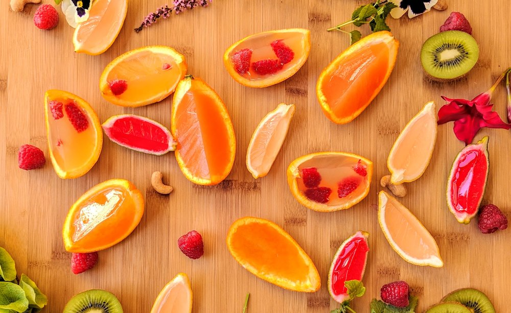 The Grapefruit Cayenne CBD jello shots are the two dark orange slices you see towards the top in this spread.