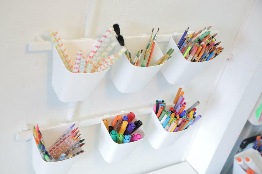 art-supply-cups-on-rail.jpg