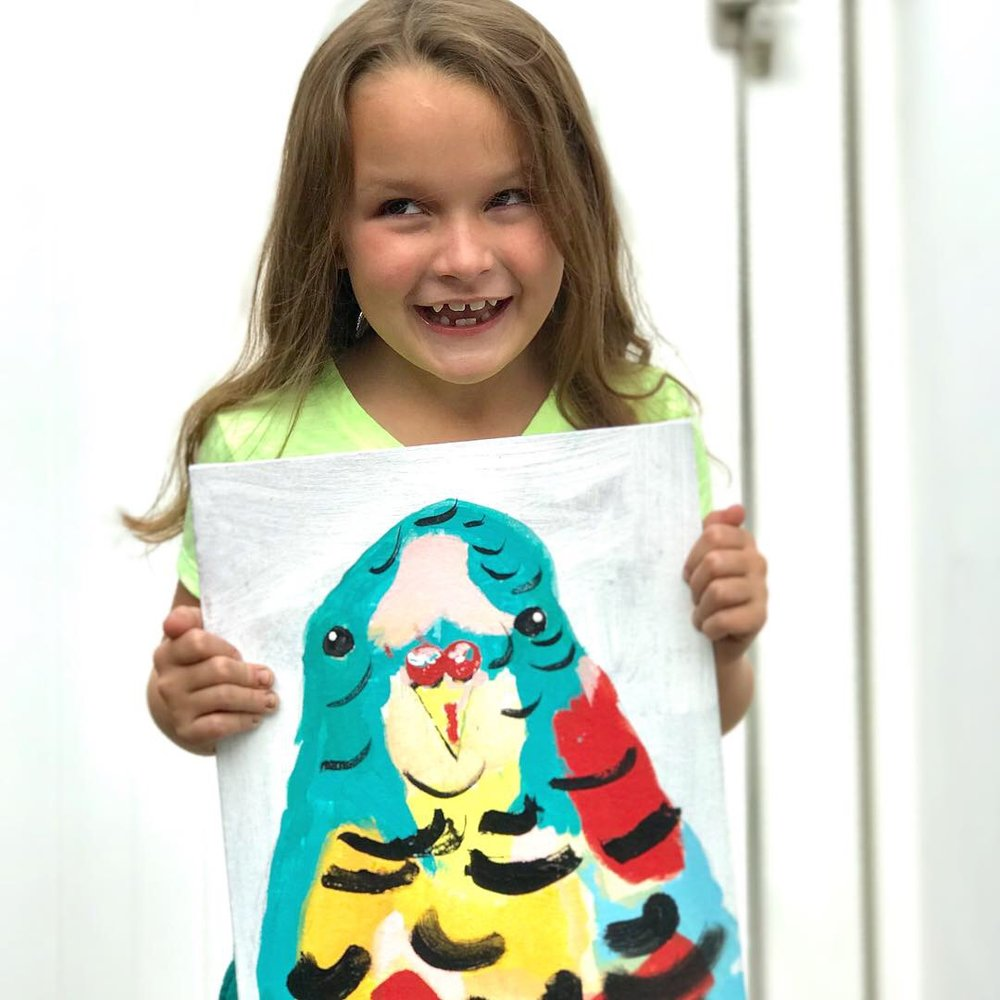 happy-kid-artist-with-budgie.JPG