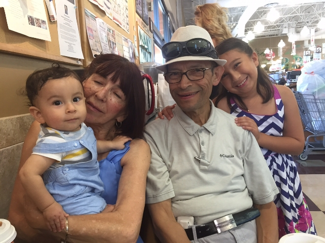 Mr. and Mrs. Garzon with their grandchildren