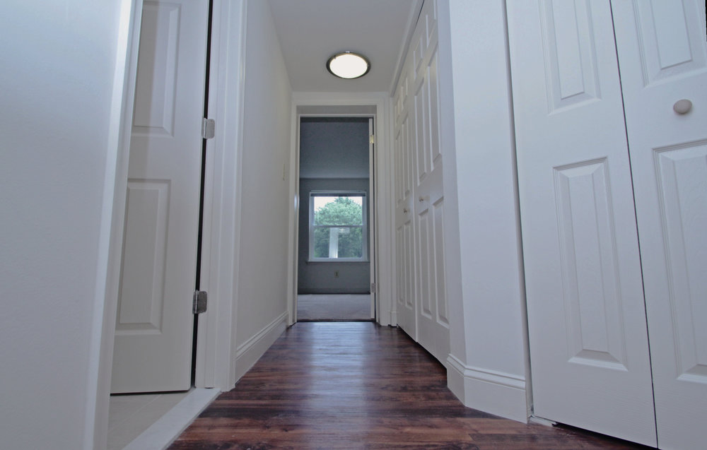 Contemporary Wood Grain Plank Flooring in Hallway