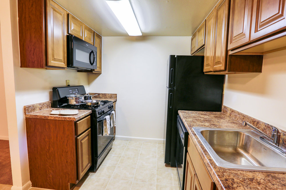 Above-Range Microwave, Maple Cabinets, Stainless Steel Kitchen Sink