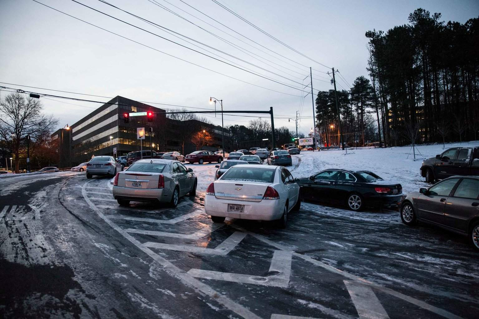 Vehicles abandoned Tuesday evening, still sat on an exit of Highway 285 in Dunwoody, GA on Wednesday. Photo credit: Associated Press