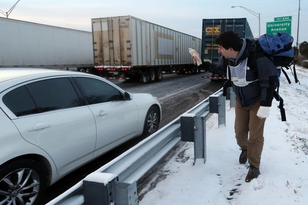 Good Samaritan Matthew Miller offered free peanut butter and jelly sandwiches, cereal and hot drinks to drivers stuck in traffic on Atlanta's Southbound Connector on Wednesday. Photo credit: Associated Press