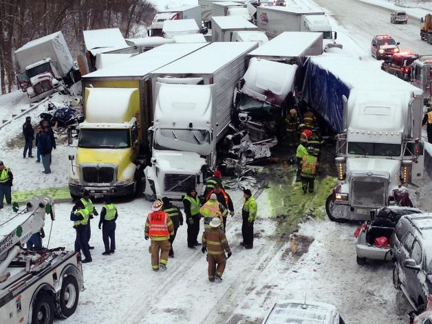 In this photo provided by the Indiana State Police, emergency crews work at the scene of a massive pileup involving about 15 semitrailers and about 15 passenger vehicles and pickup trucks along Interstate 94 on Thursday afternoon, Jan. 23, 2014 near Michigan City, Ind.AP Photo: Indiana State Police