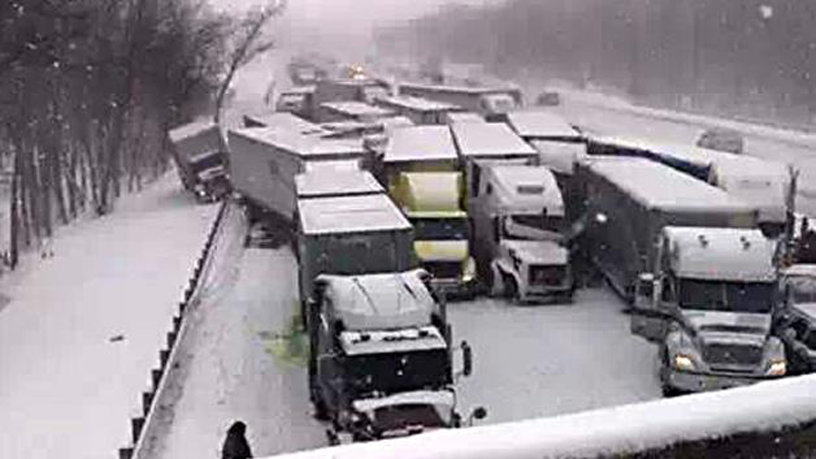 In this photo provided by the Indiana State Police, emergency crews work at the scene of a massive pileup involving about 15 semitrailers and about 15 passenger vehicles and pickup trucks along Interstate 94 Thursday afternoon, Jan. 23, 2014 near Michigan City, Ind. AP Photo: Sun-Times Media, Matt Carpenter